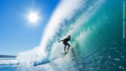 Surfer in the water; copyright: PantherMedia / EpicStockMedia
