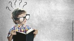 Child with large dark glasses and a book in his hand; copyright: PantherMedia / bonninturina